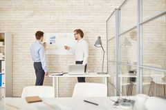 Discussing data on board Royalty Free Stock Image