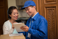 Discussing delivery details Stock Photos