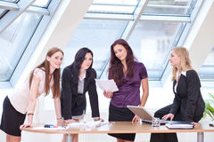 Discussing at the desk Stock Images