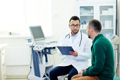 Discussing Diagnosis with Physician Royalty Free Stock Photos