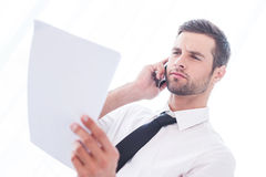 Discussing document. Royalty Free Stock Image