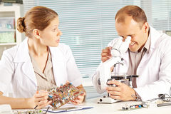 Discussing experiment in laboratory Stock Photo