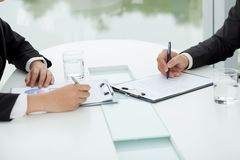 Discussing financial documents Stock Images
