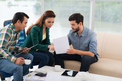 Discussing financial documents Stock Photo