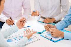 Discussing financial documents Stock Image