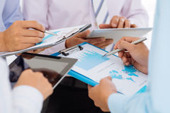 Discussing financial reports Stock Photography
