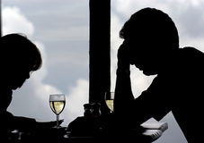 Discussing future. Man and woman in discussions over wine in the restaurant Stock Photos