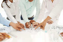 Discussing general idea. Business executives pointing at the circle diagram at the briefing royalty free stock photography