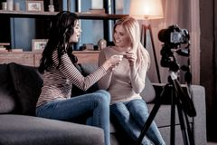 Cheerful female bloggers recording a video royalty free stock photography