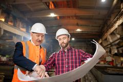 Discussing industrial sketch stock photo
