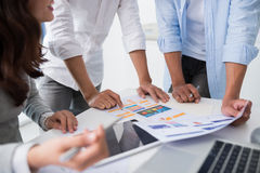 Discussing interface. Cropped image of development team discussing interface of new application Stock Photos