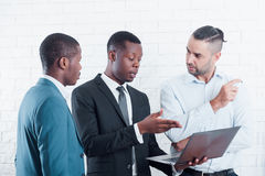 Discussing new project with company office workers royalty free stock photos