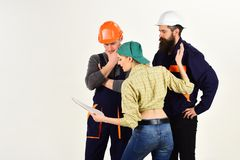 Discussing a new project. Group of constructing engineers and architects at work. Professional people working on. Construction design. Men and women builders stock image