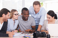 Discussing new project together. Royalty Free Stock Photo