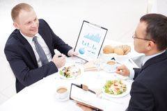 Discussing paper at lunch Royalty Free Stock Photos