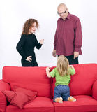 Discussing parents with kneeling on sofa daughter Royalty Free Stock Photo