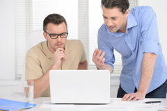 Discussing the problem. Two confident business man discussing so Stock Photo