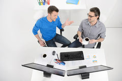 Discussing the project done. Top view of two businessmen dicussi Royalty Free Stock Images