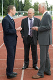 Discussing On A Racetrack -2 Stock Image