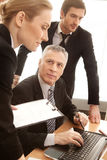 Discussing a report. Royalty Free Stock Image