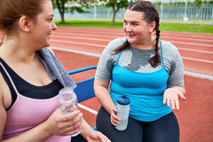 Discussing results of workout stock photo
