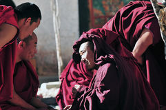 Discussing scriptures monks in Tibet. Tibetan monks at Sera monastery debating in the courtyard Stock Photos