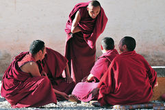 Discussing scriptures monks in Tibet. Tibetan monks at Sera monastery debating in the courtyard Stock Image