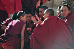 Discussing scriptures monks in Tibet. Tibetan monks at Sera monastery debating in the courtyard Stock Photography