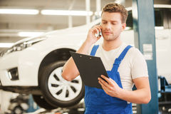 Discussing some car problems. Stock Images