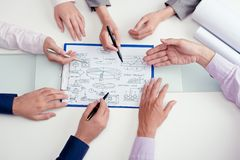 Discussing start-up project. Hands of business team discussing start-up project Royalty Free Stock Photo