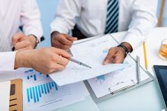 Discussing statistics Royalty Free Stock Photo