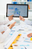 Discussing statistics Royalty Free Stock Images