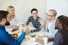 Discussing topical issue in boardroom Royalty Free Stock Image