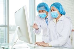 Discussing Treatment Methods with Colleague stock photography