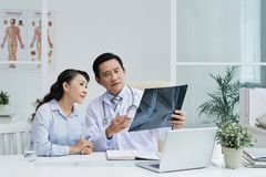 Discussing Treatment with Surgeon Stock Image