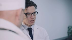 Discussing of two doctors in the hospital. 4K.  stock video