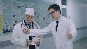 Discussing of two doctors in the hospital. 4K.  stock footage