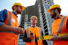 Discussing unfinished building Stock Images