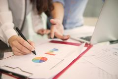 Discussing, writing, estimating business profit plan of company Royalty Free Stock Image