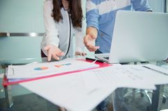 Discussing, writing, estimating business profit plan of company.  Stock Images