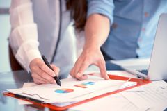 Discussing, writing, estimating business profit plan of company.  Stock Photography