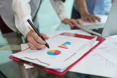 Discussing, writing, estimating business profit plan of company. Discussing,writing, estimating business profit plan of company Royalty Free Stock Photo