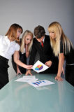 Discussion. Team of man and womens think about documents Royalty Free Stock Image
