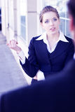 In discussion. A businesswoman in discussions with an associate Royalty Free Stock Photos