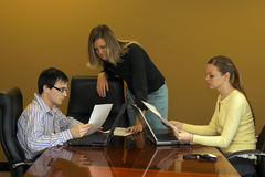 Discussion. Group of young professionals in a meeting Royalty Free Stock Photos