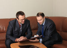Discussion of agreement. A discussion of agreement two businessmen is in an office Royalty Free Stock Photo