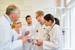 Discussion betweend doctors. In meeting at hospital royalty free stock images