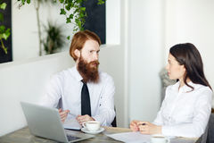 Discussion in cafe Royalty Free Stock Photography