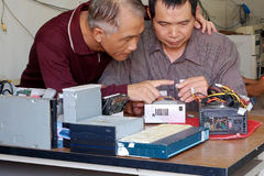 Discussion of Computer repair Royalty Free Stock Photos