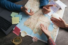 Discussion and controversy planning travel. Couple reserching Europe map. Top view. Table with map hands and compass stock photos